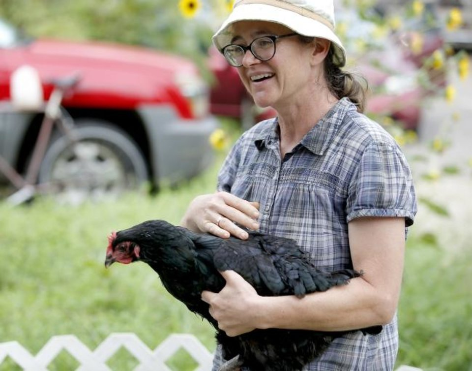 Photo -  Sara Braden holds Bessie while talking about backyard chickens during a class at CommonWealth Urban Farms, 3310 N Olie. [SARAH PHIPPS, THE OKLAHOMAN]