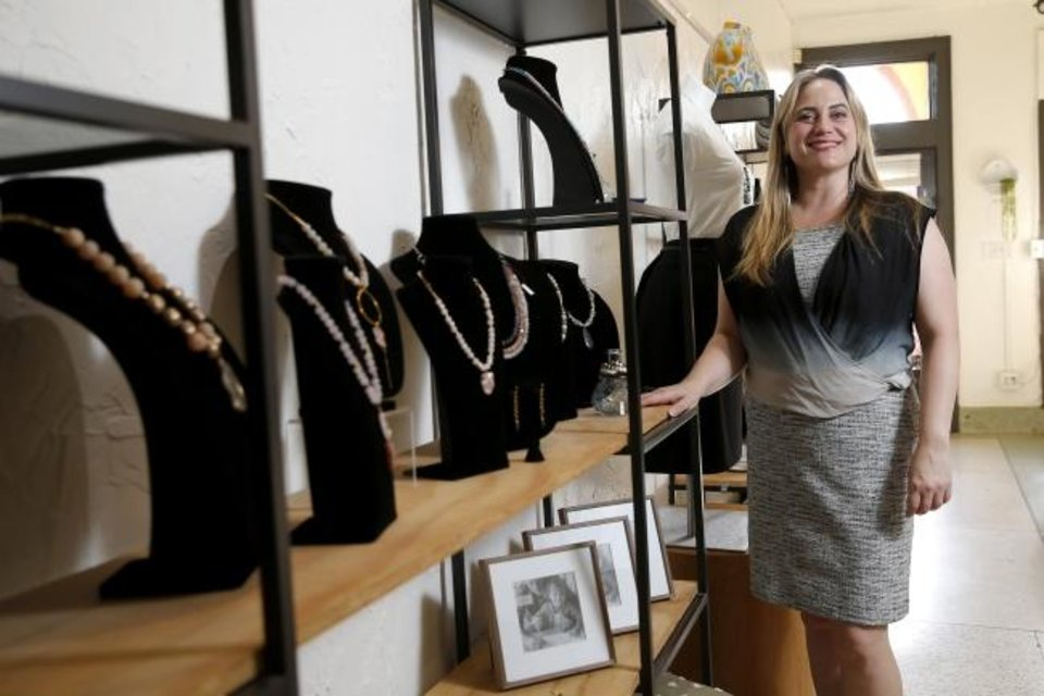 Photo -  Jeweler Jennifer Woods is seen on Aug. 7 inside her new Paseo Arts District studio and gallery, Jennifer Woods Jewelry & Home. [Bryan Terry/The Oklahoman]