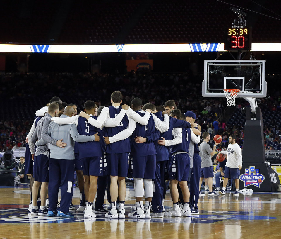 Photo - Villanova huddles up during practice on Final Four Friday before the national semifinal between the Oklahoma Sooners and the Villanova Wildcats in the NCAA Men's Basketball Championship at NRG Stadium in Houston, Friday, April 1, 2016. OU will play Villanova in the Final Four on Saturday. Photo by Nate Billings, The Oklahoman