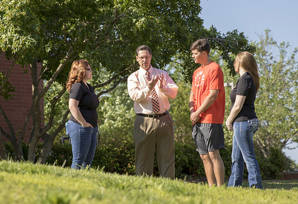 Photo - OSU Institute of Technology President Bill Path talks with students on the Okmulgee campus on spring 2017. [Photo Provided by OSUIT Marketing & Communications Services]