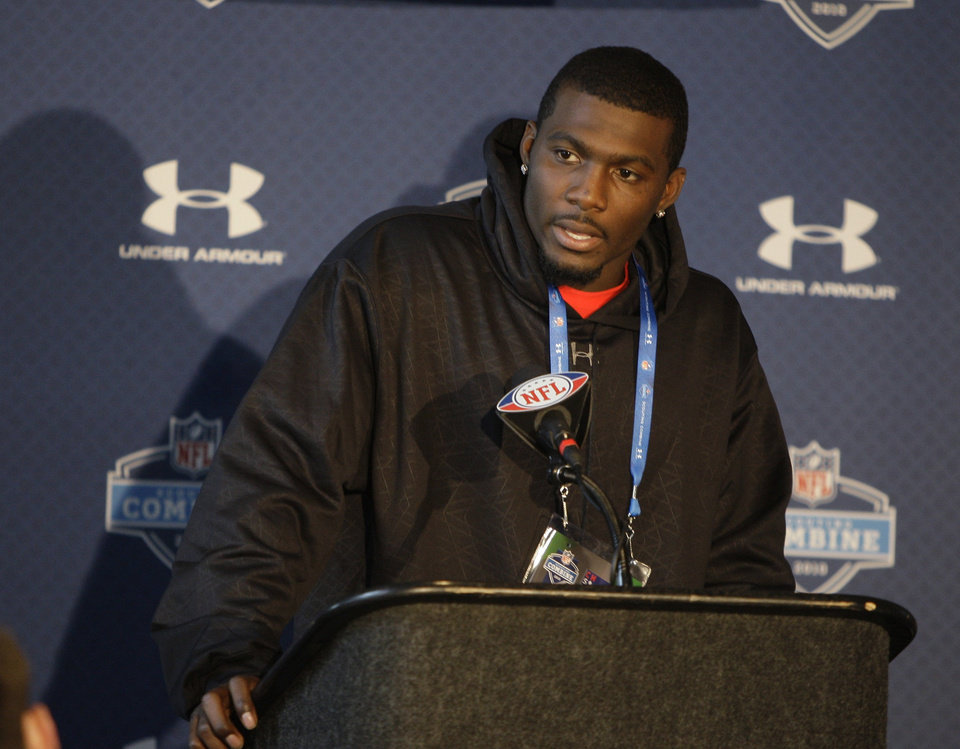 Photo -  FORMER OSU: Oklahoma State University's Dez Bryant listens to a question during a press conference at the NFL Scouting Combine in Indianapolis, Friday, Feb. 26, 2010. (AP Photo/Darron Cummings) ORG XMIT: INDC114