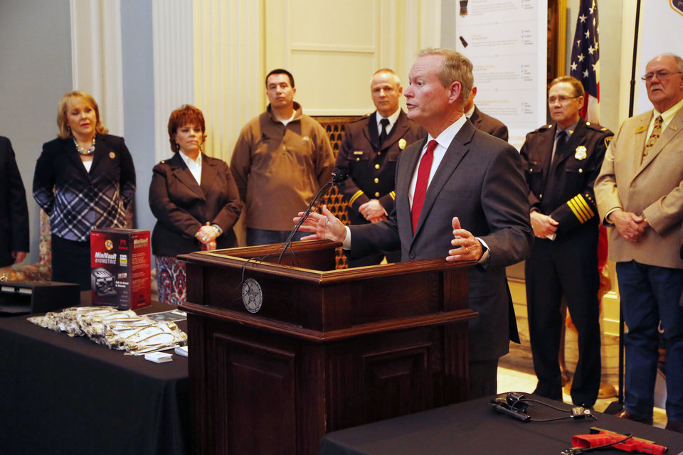Photo -  Oklahoma City Mayor Mick Cornett speaks Wednesday about responsible firearms ownership. [Photo by Paul Hellstern, The Oklahoman]