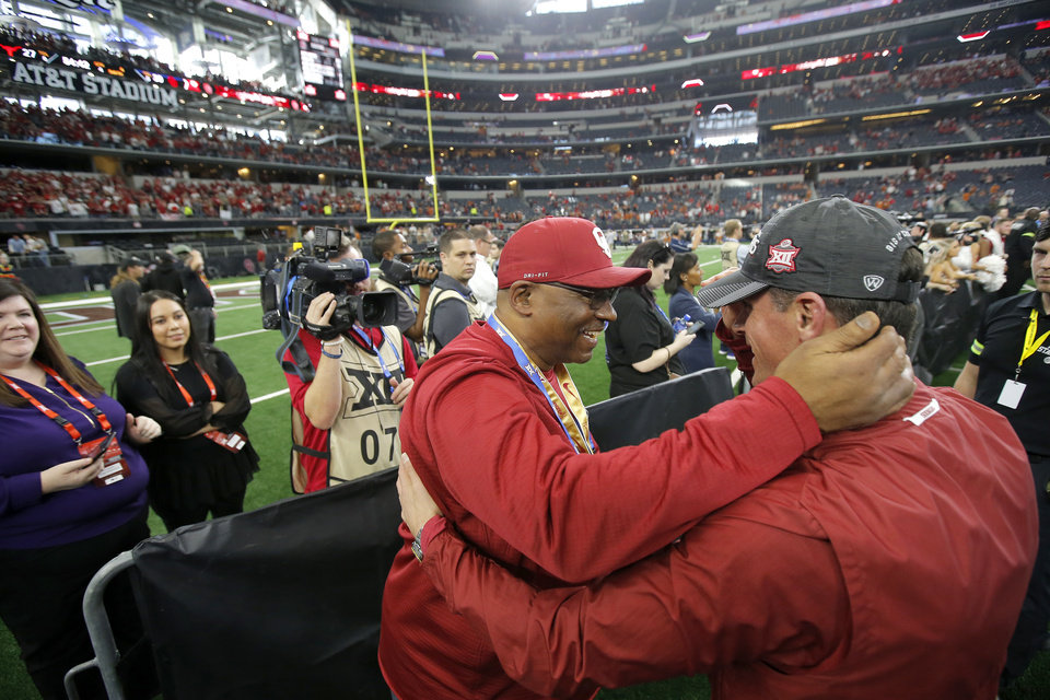 Photo - Ruffin McNeill celebrates after the Big 12 Championship football game between the Oklahoma Sooners (OU) and the Texas Longhorns (UT) at AT&T Stadium in Arlington, Texas, Saturday, Dec. 1, 2018.  Oklahoma won 39-27. Photo by Bryan Terry, The Oklahoman