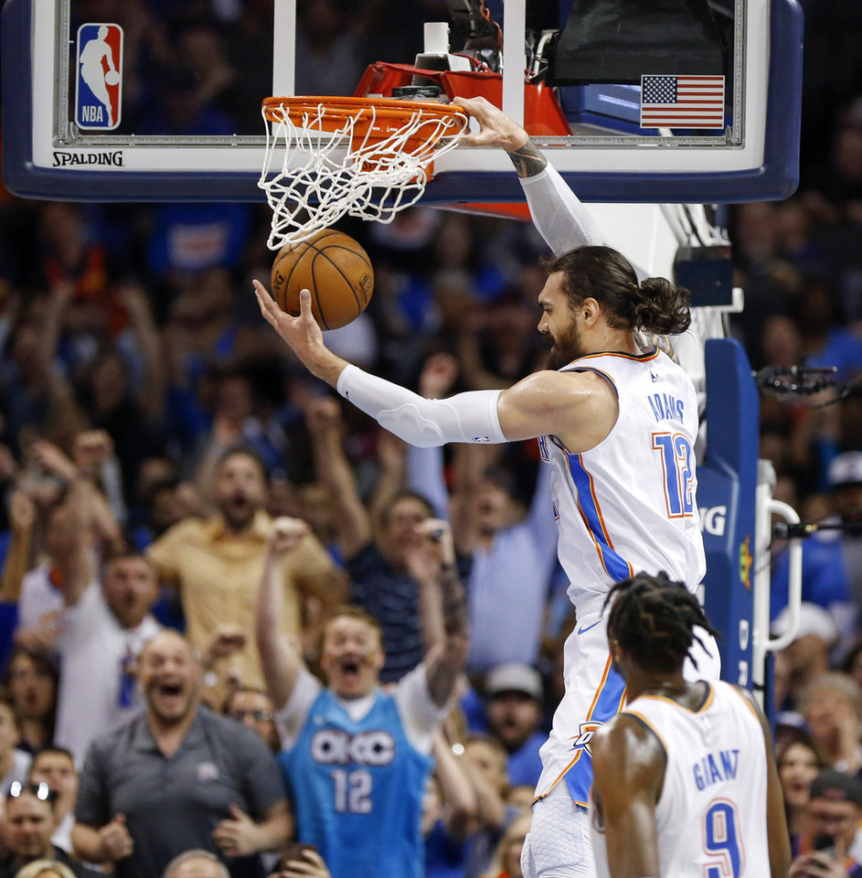 Photo - Oklahoma City's Steven Adams (12) dunks the ball after receiving a pass from Russell Westbrook, not pictured, in front of Jerami Grant (9) in the third quarter during an NBA basketball game between the Detroit Pistons and the Oklahoma City Thunder at Chesapeake Energy Arena in Oklahoma City, Friday, April 5, 2019. Oklahoma City won 123-110. Photo by Nate Billings, The Oklahoman