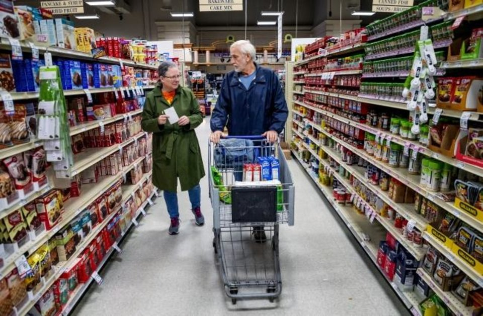 Photo -  Customers Lynda and Terry Witty shop for groceries Thursday morning at the Homeland store at 2400 S Cornwell in Yukon. Homeland stores have dedicated the first hour of store operations to senior customers and those who have medical conditions that put them at higher risk from COVID-19.  [Chris Landsberger/The Oklahoman]