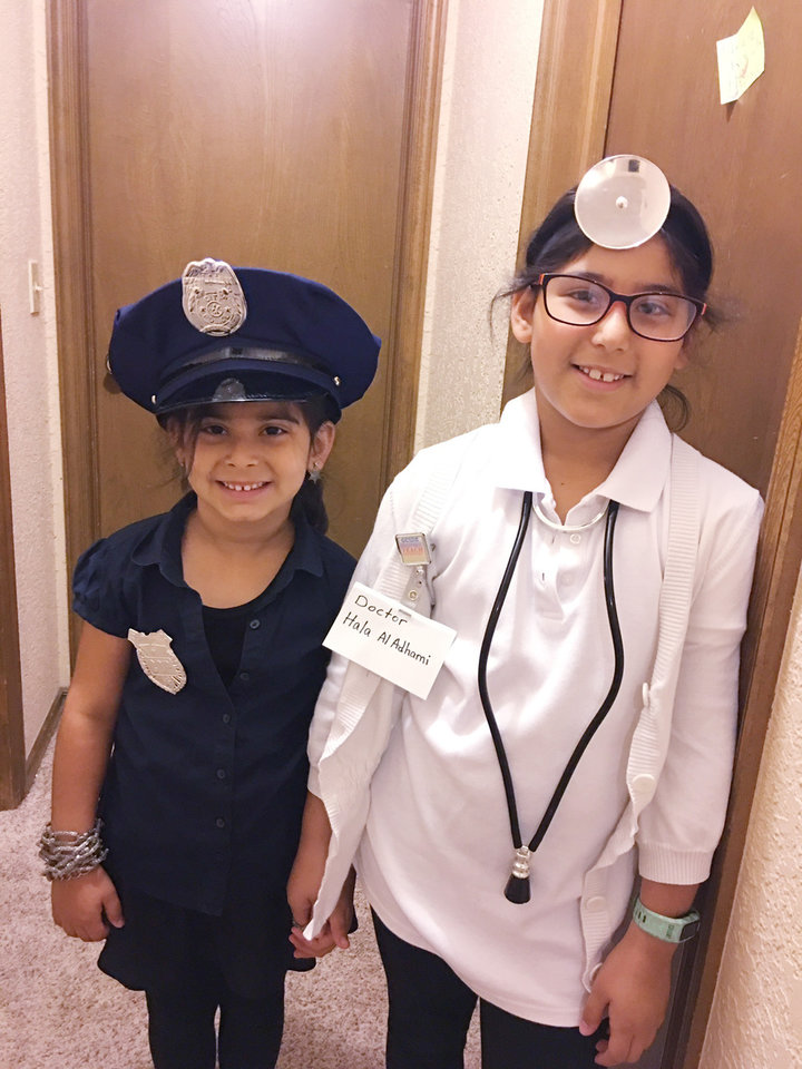 Photo -  Lamar and Hala Al-Adhami dress up for Future Career Day at school. [Photo provided]
