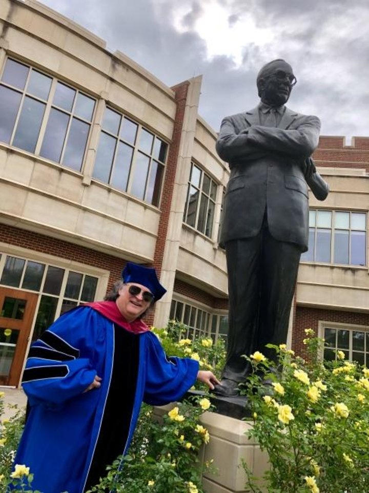 Photo -  Phil Todd graduated from the University of Oklahoma on Saturday, wearing his late wife's blue Kentucky robes in tribute. [Provided]