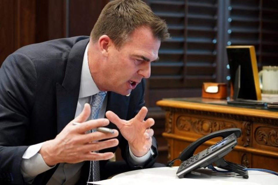 Photo -  Gov. Kevin Stitt visits with President Joe Biden on Feb. 16 about Oklahoma's need for federal assistance in the wake of last week's winter storm. [PROVIDED BY STATE OF OKLAHOMA]