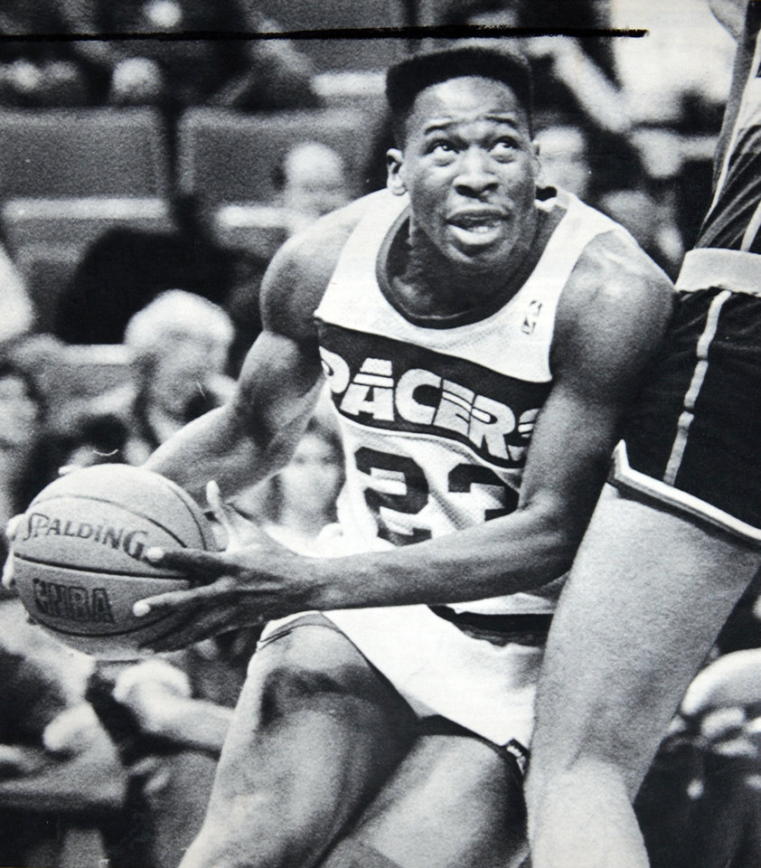 Photo - Former OU basketball player Wayman Tisdale. April 12, 1988.  TISDALE STARTING - Indiana Pacer Wayman Tisdale moves down the baseline as he eyes a bucket during NBA action in Indianapolis. Tisdale, a three-time All-American at Oklahoma, has been a reserve for most of his first two NBA seasons. Since Feb. 3, Tisdale has been in the starting lineup and has scored in double figures 25 of the last 26 games. Photo by Michael Conroy. Photo taken 4/12/1988, Photo published 4/13/1988, 6/16/1988, 7/16/1988, 11/29/1988, 2/20/1989 in The Daily Oklahoman. ORG XMIT: KOD