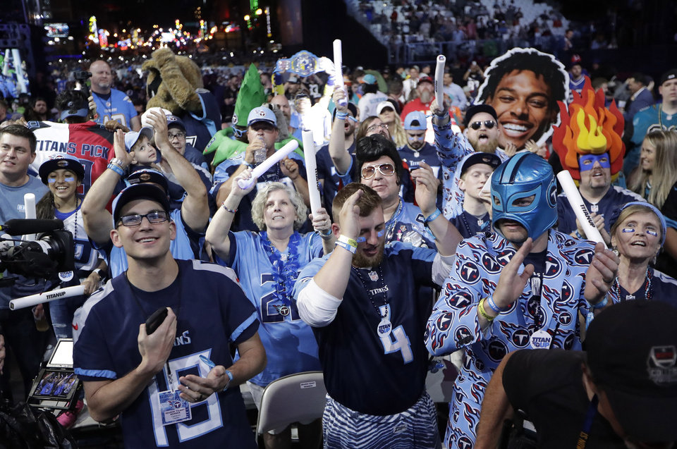 Photo - Fans watch the action on the main stage during the first round at the NFL football draft, Thursday, April 25, 2019, in Nashville, Tenn. (AP Photo/Mark Humphrey)