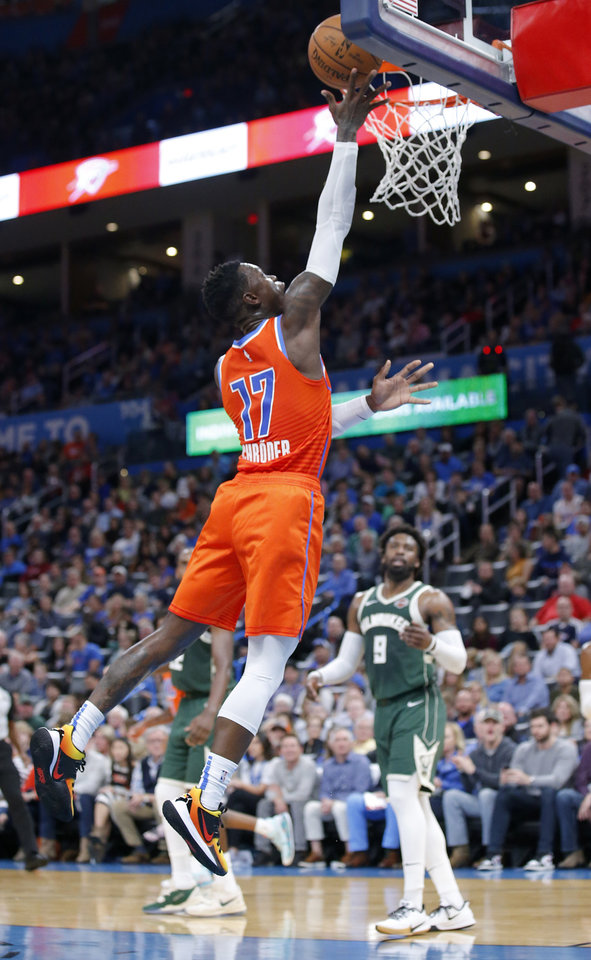 Photo - Oklahoma City's Dennis Schroder (17) goes up for a lay up during the NBA game between the Oklahoma City Thunder and the Milwaukee Bucks at Chesapeake Energy Arena,   Sunday, Nov. 10, 2019.  [Sarah Phipps/The Oklahoman]