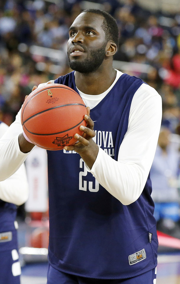 Photo - Villanova's Daniel Ochefu (23) practices during Final Four Friday before the national semifinal between the Oklahoma Sooners and the Villanova Wildcats in the NCAA Men's Basketball Championship at NRG Stadium in Houston, Friday, April 1, 2016. OU will play Villanova in the Final Four on Saturday. Photo by Nate Billings, The Oklahoman