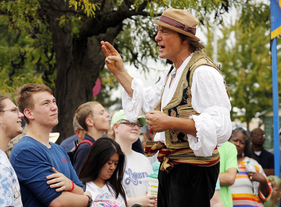 Photo -  Giovanni Zoppe entertains the crowd waiting to see Zoppe Circus at the Oklahoma State Fair on Thursday.
