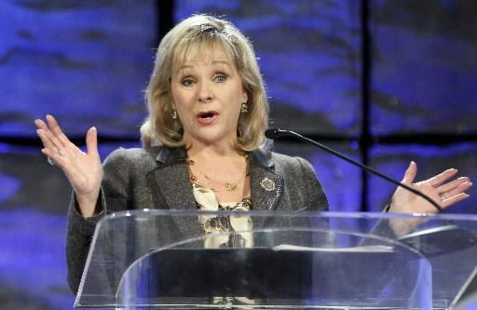 Photo - Oklahoma Gov. Mary Fallin gestures as she speaks to an energy conference in Oklahoma City, Thursday, Oct. 4, 2012. (AP Photo/Sue Ogrocki)