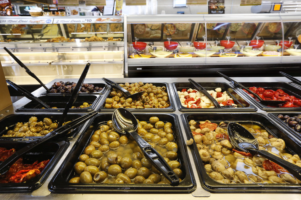 Photo -  Additions to the remodeled Homeland at NW 18 and Classen include an olive bar. [Photo by Jim Beckel, The Oklahoman]