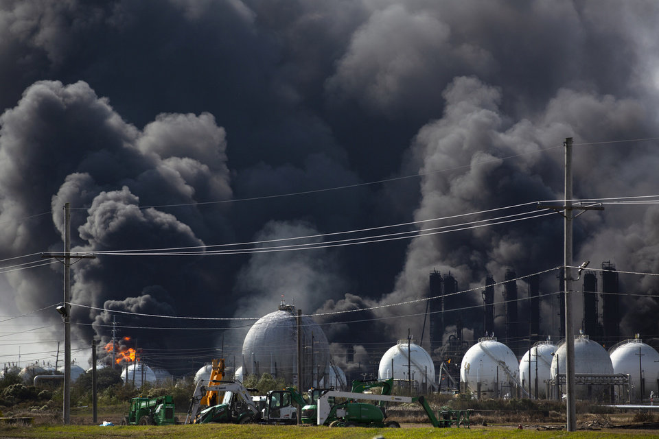 Photo -  Smoke from an explosion at the TPC Group plant is seen Wednesday in Port Neches, Texas. [Marie D. De Jesús/Houston Chronicle via The Associated Press]