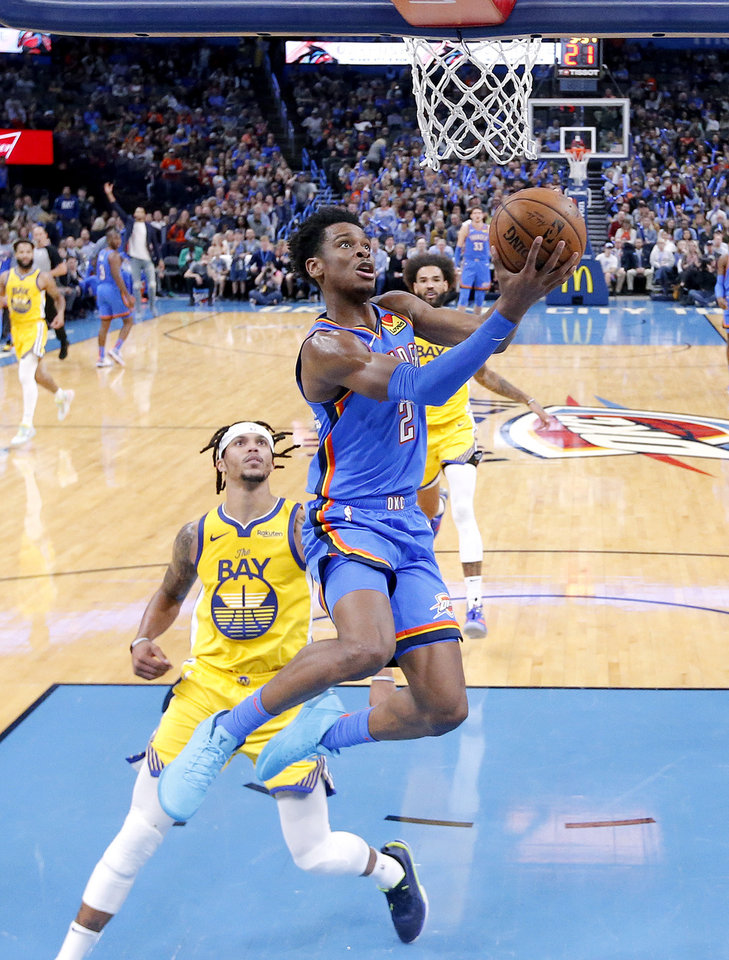 Photo - Oklahoma City's Shai Gilgeous-Alexander (2) goes up for a basket in front of Golden State's Damion Lee (1) during the NBA game between the Oklahoma City Thunder and the Golden State Warriors at Chesapeake Energy Arena,   Saturday, Nov. 9, 2019.  [Sarah Phipps/The Oklahoman]