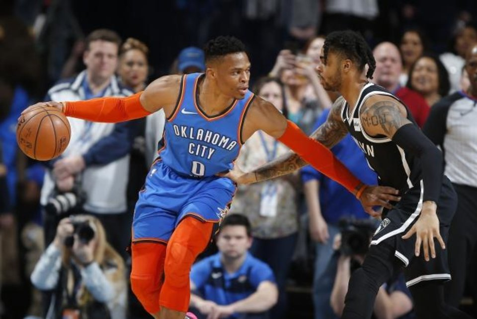 Photo -  Oklahoma City's Russell Westbrook (0) tries to get past Brooklyn's D'Angelo Russell (1) during an NBA basketball game between the Oklahoma City Thunder and the Brooklyn Nets at Chesapeake Energy Arena in Oklahoma City, Wednesday, March 13, 2019. Photo by Bryan Terry, The Oklahoman