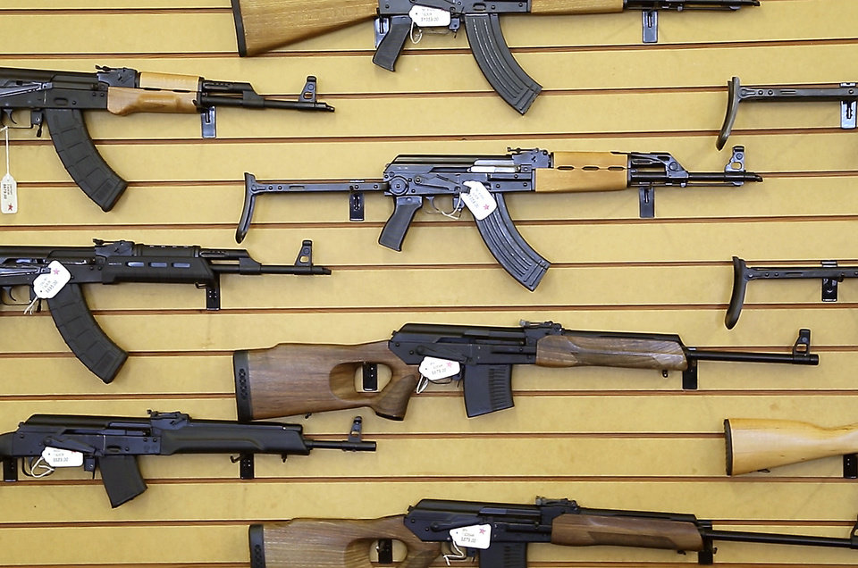 Photo -  A display shows rifles for sale Friday at Big Boys Guns & Ammo. Photo by Bryan Terry, The Oklahoman