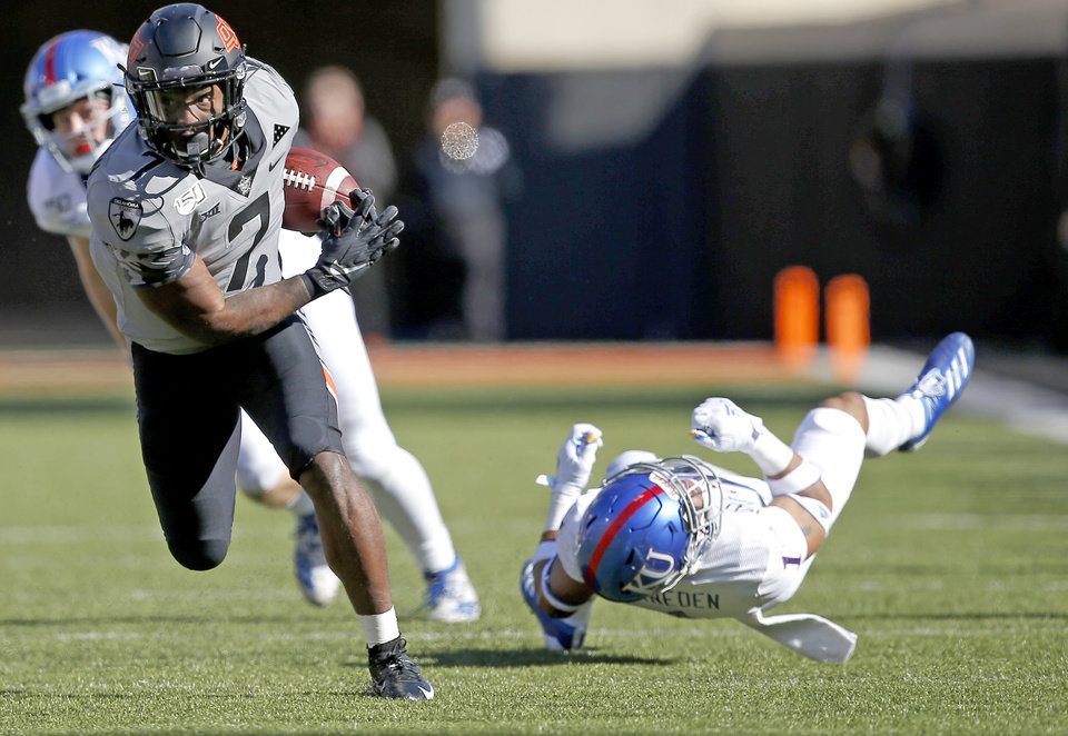 Photo - Oklahoma State's LD Brown (7) gets by Kansas's Bryce Torneden (1) in the third quarter during the college football game between the Oklahoma State University Cowboys and the Kansas Jayhawks at Boone Pickens Stadium in Stillwater, Okla., Saturday, Nov. 16, 2019. OSU won 31-13. [Sarah Phipps/The Oklahoman]