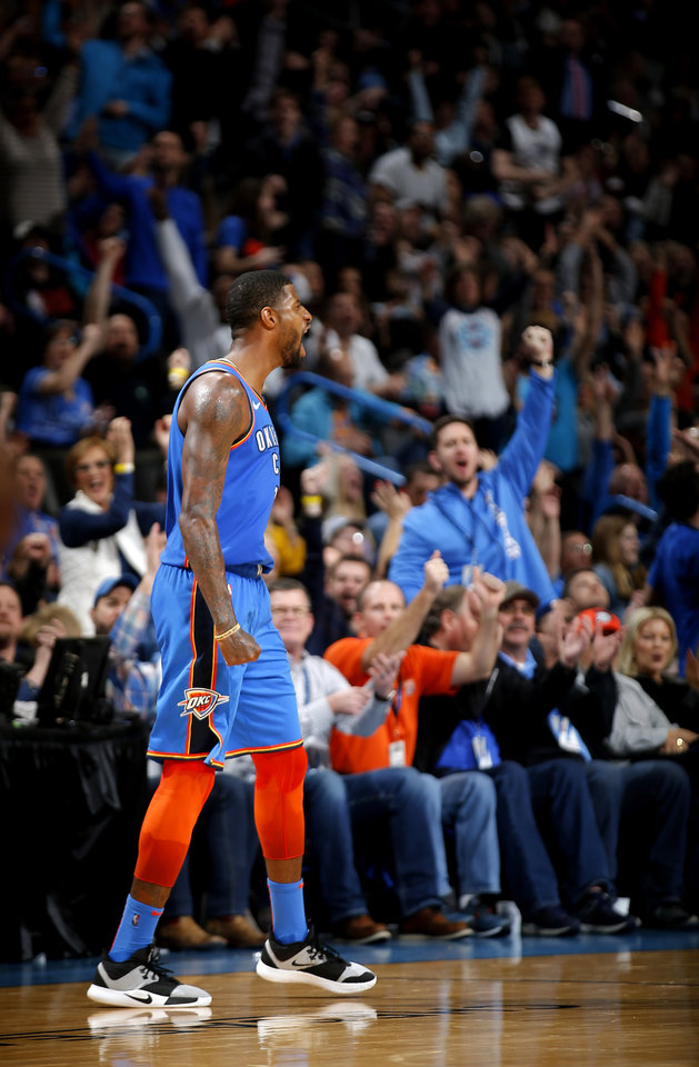Photo - Oklahoma City's Paul George (13) celebrates a 3-point basket during the NBA game between the Oklahoma City Thunder and the Utah Jazz at the Chesapeake Energy Arena, Friday, Feb. 22, 2019. Photo by Sarah Phipps, The Oklahoman