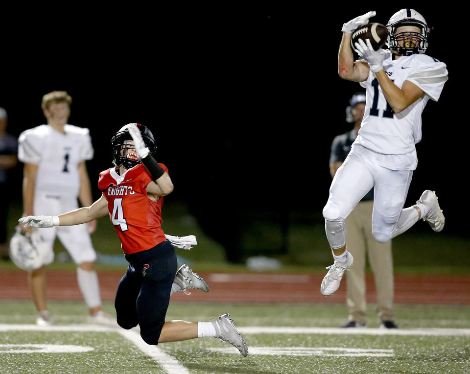 Photo - Minco's Kenny Fouch intercepts a pass intended for Logan McGowan of Crossings during a high school football game between Crossings Christian and Minco in Oklahoma City, Friday, Sept. 13, 2019. [Bryan Terry/The Oklahoman]