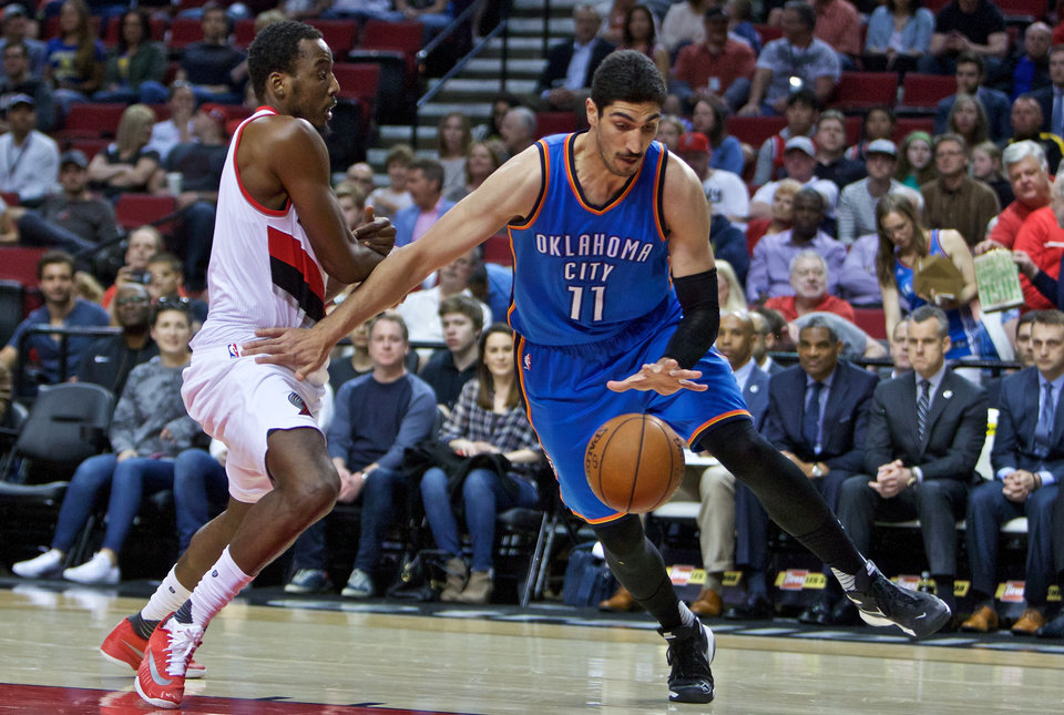 Photo -  Oklahoma City Thunder center Enes Kanter, right, dribbles past Portland Trail Blazers forward Al-Farouq Aminu during the first half of an NBA basketball game in Portland, Ore., Wednesday, April 6, 2016. (AP Photo/Craig Mitchelldyer)