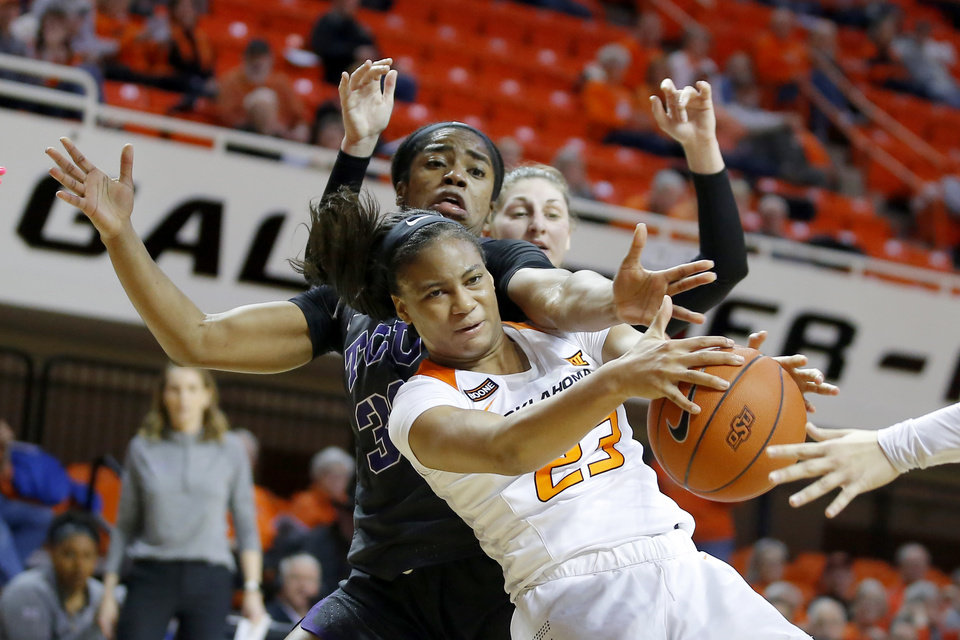 Photo - Oklahoma State's Lauren Fields (23) goes for the rebound beside TCU's Adeola Akomolafe (33) during a women's NCAA basketball game between the Oklahoma State University Cowgirls (OSU) and the TCU Horned Frogs at Gallagher-Iba Arena in Stillwater, Okla., Wednesday, Jan. 29, 2020. [Bryan Terry/The Oklahoman]