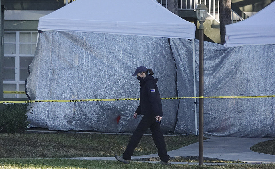 Photo -  Law enforcement personnel continue to work at an apartment complex the day after a deadly shooting in Sunrise, Fla., Wednesday, Feb. 3, 2021. Several FBI agents were killed and others were wounded while trying to serve a search warrant on a child pornography suspect in Florida. FBI authorities say the suspect also died. (Joe Cavaretta/South Florida Sun-Sentinel via AP)