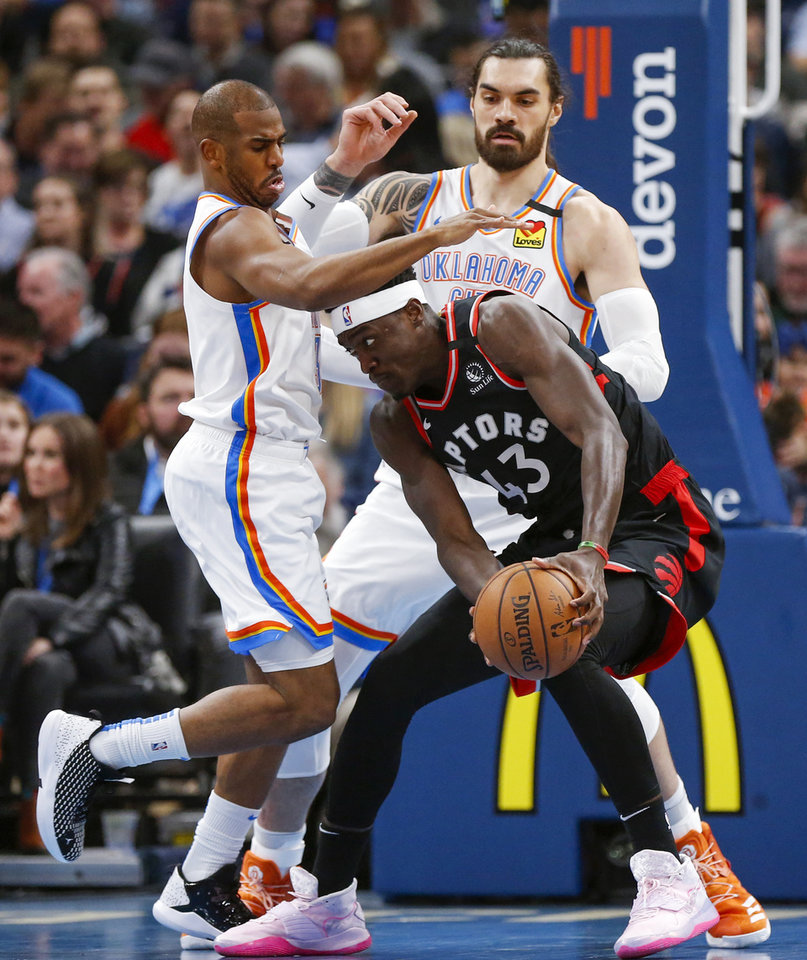 Photo - Oklahoma City's Chris Paul (3), left, and Steven Adams (12) defend Toronto's Pascal Siakam (43) in the first quarter during an NBA basketball between the Oklahoma City Thunder and the Toronto Raptors at Chesapeake Energy Arena in Oklahoma City, Wednesday, Jan. 15, 2020. [Nate Billings/The Oklahoman]
