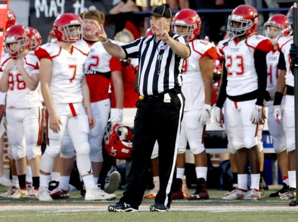 Photo -  Corey Miller, pictured here officiating the Class 5A state championship game, had quite the Saturday on Dec. 7. Not long before officiting the game, he was coaching his high school basketball team 100 miles away. [Sarah Phipps/The Oklahoman]