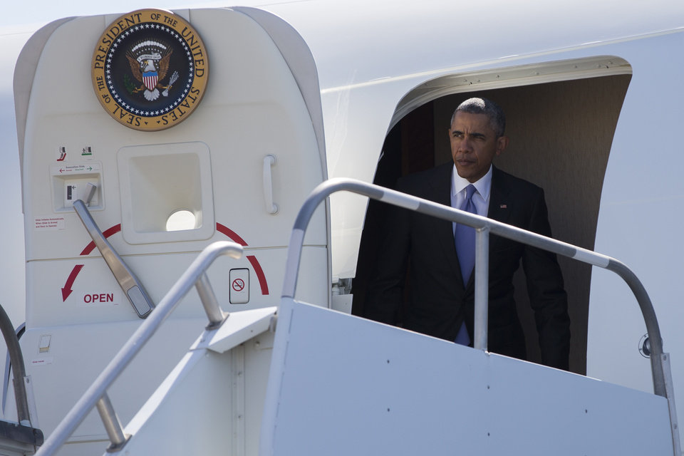 Photo - President Barack Obama arrives at North Texas Regional Airport, on Wednesday, July 15, 2015, in Denison, Texas. Obama is traveling to Durant, Okla., to speak in the Choctaw Nation on economic opportunities for underprivileged communities across the nation. (AP Photo/Evan Vucci)