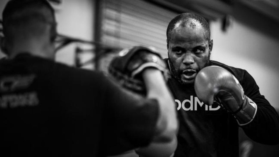 Photo -  Former Oklahoma State wrestler and UFC champion Daniel Cormier revealed in an interview with Yahoo! Sports on Tuesday that he tested positive for COVID-19 during training camp for his trilogy bout against Stipe Miocic, which took place Aug. 15. [BUSINESS WIRE]