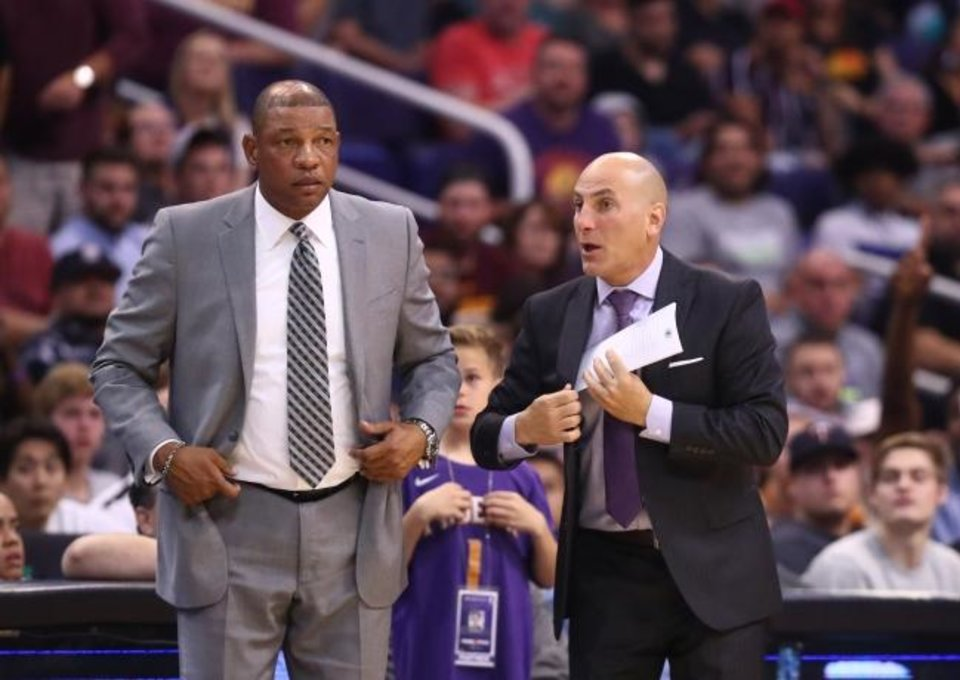 Photo -  Los Angeles Clippers head coach Doc Rivers (left) and assistant coach Rex Kalamian watch the action against the Phoenix Suns. Kalamian might be a candidate to fill the open heading coaching job in Oklahoma City.  [Mark J. Rebilas/USA TODAY Sports]