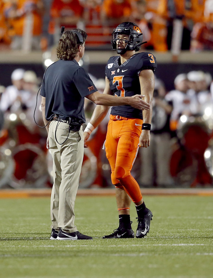 Photo - Oklahoma State's Spencer Sanders (3) talks to head coach Mike Gundy in the second quarter during the college football game between the Oklahoma State Cowboys and the Kansas State Wildcats at Boone Pickens Stadium in Stillwater, Okla., Saturday, Sept. 28, 2019. [Sarah Phipps/The Oklahoman]