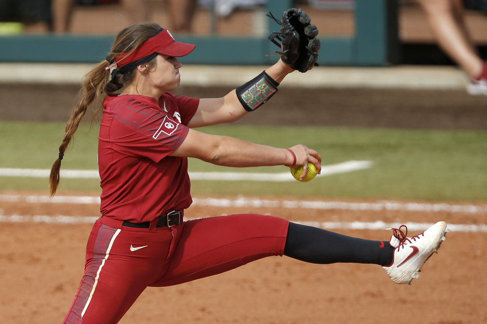 Photo - Oklahoma's Shannon Saile (4) pitches during the second softball game in the Norman Super Regional between the University of Oklahoma (OU) and Northwestern in Norman, Okla., Saturday, May 25, 2019. Oklahoma won 8-0 to send them to the Women's College World Series. [Bryan Terry/The Oklahoman]