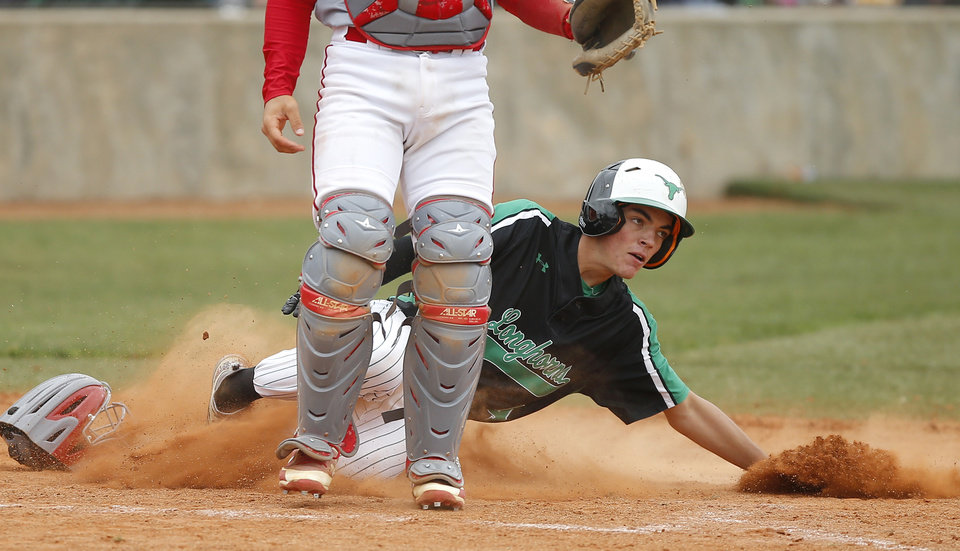 Photo - Lucas Collier of Jones slides home during a Class 3A state baseball game against Kingston at Edmond Memorial in Edmond, Okla., Thursday, May 9, 2019. [Bryan Terry/The Oklahoman]