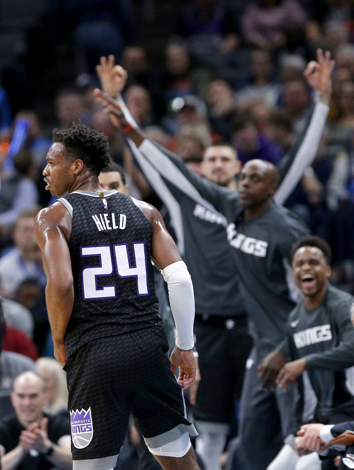 Photo -  Sacramento's Buddy Hield and teammates react after the former OU star hit a 3-pointer on Thursday night against Oklahoma City. Hield scored 15 points, all from 3-point range, in the Kings' 112-108 loss to the Thunder at Chesapeake Energy Arena. [Sarah Phipps/The Oklahoman]