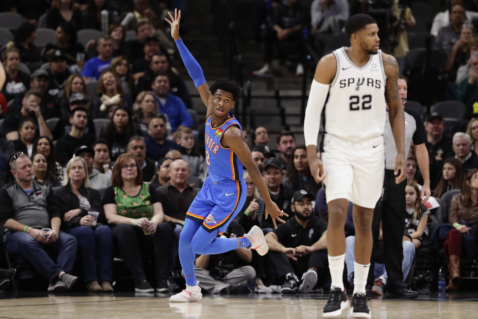 Photo - Oklahoma City Thunder guard Shai Gilgeous-Alexander (2) celebrates after scoring against the San Antonio Spurs during the second half of an NBA basketball game, in San Antonio, Thursday, Jan. 2, 2020. Oklahoma City won 109-103. (AP Photo/Eric Gay)