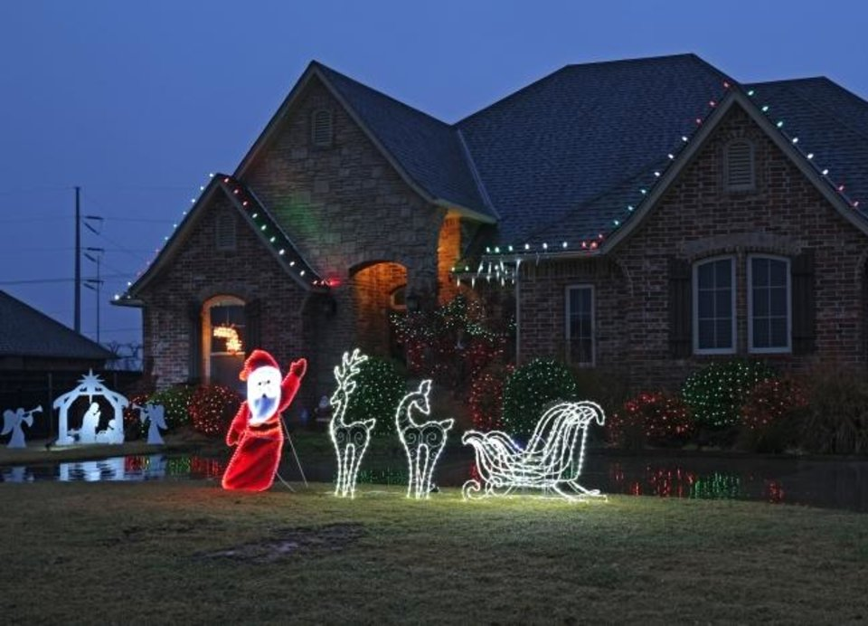 Photo -  Christmas decorations at 16123 Silver Run Drive in Choctaw. [DOUG HOKE/THE OKLAHOMAN]