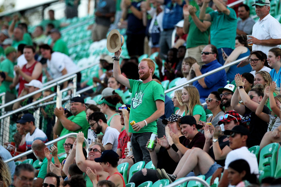 Photo - A fan stand and waves his hat after OKC Energy FC made a goal in the game against Reno 1868 FC at Taft Stadium in Oklahoma City, Oklahoma on July 17, 2019. [Paxson Haws/The Oklahoman]