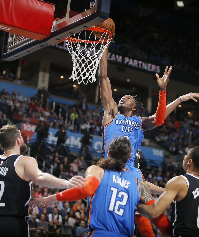 Photo - Oklahoma City's Jerami Grant (9) goes to the basket during an NBA basketball game between the Oklahoma City Thunder and the Brooklyn Nets at Chesapeake Energy Arena in Oklahoma City, Wednesday, March 13, 2019. Oklahoma City won 108-96. Photo by Bryan Terry, The Oklahoman