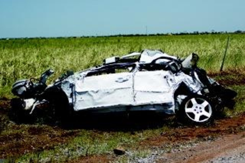 Photo - Remains of an automobile found along Jensen Road in El Reno. Traci Chapman