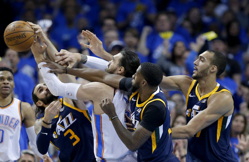 Photo -  Thunder center Steven Adams tries to grab a rebound Sunday while surrounded by a slew of Jazz players, including Ricky Rubio (3), Royce O'Neale (23) and Rudy Gobert (27). [PHOTO BY SARAH PHIPPS, THE OKLAHOMAN]