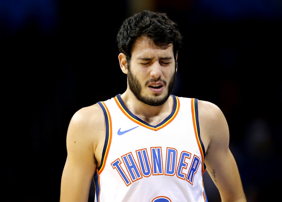 Photo - Oklahoma City's Alex Abrines (8) reacts after an injury  during the NBA game between the Oklahoma City Thunder and the Charlotte Hornets at the Chesapeake Energy Arena,  Friday, Nov. 23, 2018.Photo by Sarah Phipps, The Oklahoman