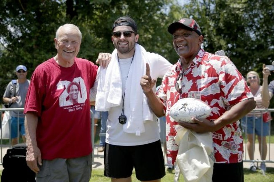 Photo -  Baker Mayfield, center, poses for a photo with former Oklahoma coach Barry Switzer, left, and fellow Heisman winner Billy Sims during Mayfield's camp June 19 in Norman. [Bryan Terry/The Oklahoman]