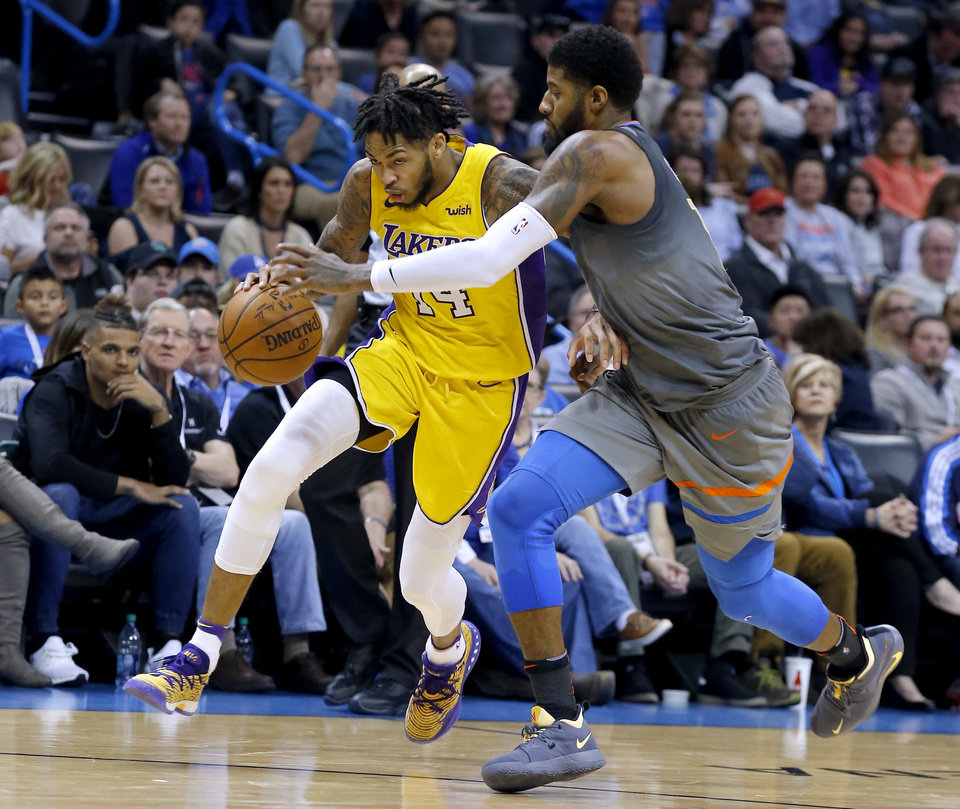 a36577fa9ccd Oklahoma City s Paul George (13) defends against Los Angeles  Brandon  Ingram (14) during the NBA basketball game between the Oklahoma City Thunder  and the ...