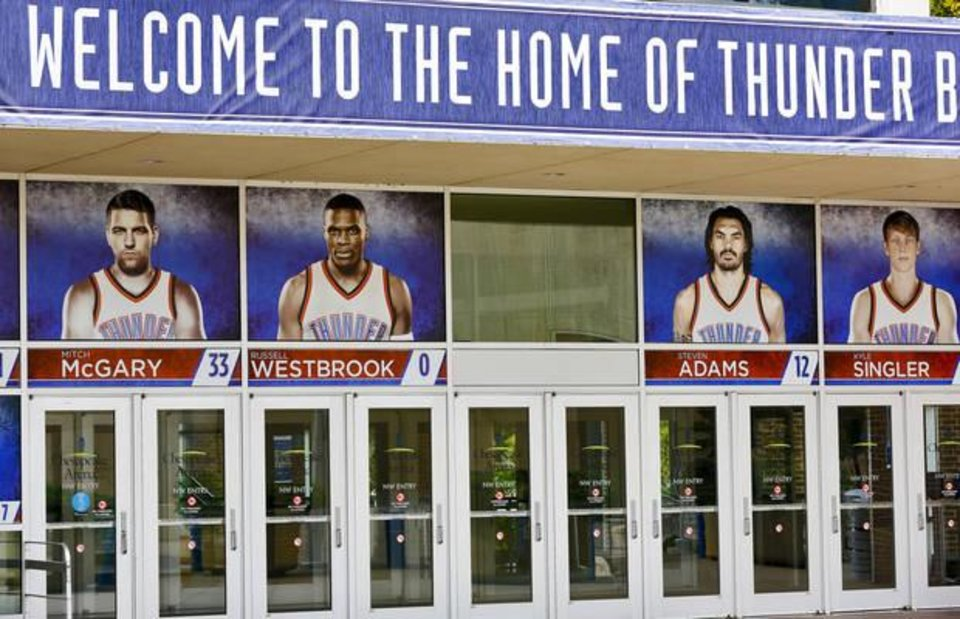 Photo - Former Oklahoma City Thunder player Kevin Durant's photo has been removed from the entrance to the Chesapeake Energy Arena in Oklahoma City, Okla. on Tuesday, July 5, 2016. Photo by Jim Beckel, The Oklahoman