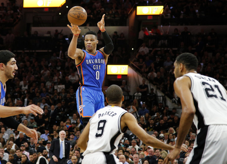 Photo - Oklahoma City's Russell Westbrook (0) passes over San Antonio's Tony Parker (9) and Tim Duncan (21) during Game 5 of the second-round series between the Oklahoma City Thunder and the San Antonio Spurs in the NBA playoffs at the AT&T Center in San Antonio, Tuesday, May 10, 2016. Oklahoma City won 95-91. Photo by Bryan Terry, The Oklahoman