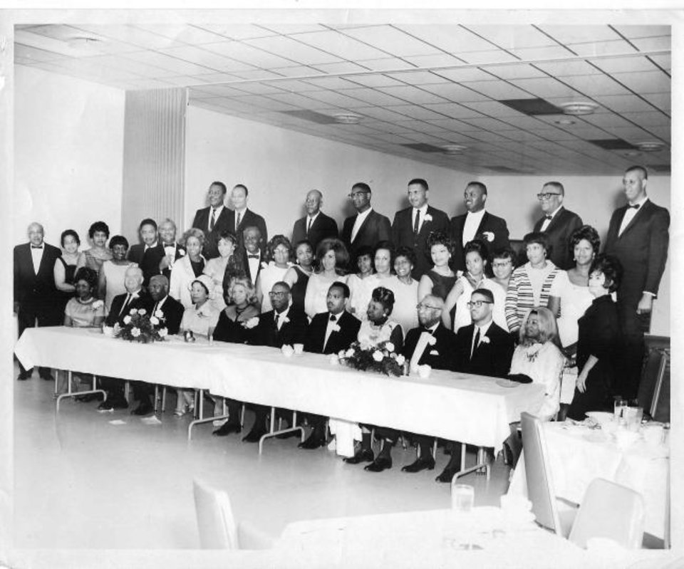 Photo -  Members of the Oklahoma City chapter of the National Association of Real Estate Brokers pose for a photo in the 1960s, the chapter's heyday. Carl Carbin, 90, a member in the 1960s, is sixth from the left in the front row. [OKLAHOMAN ARCHIVES]